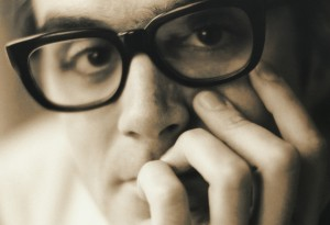 Sepia close-up of guy with black glasses